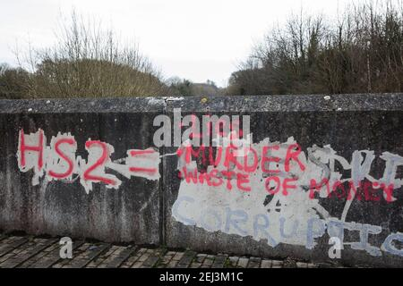Wendover, UK. 20th February, 2021. Anti-HS2 graffiti on a wall close to woodland which is currently being cleared for the HS2 high-speed rail link. Anti-HS2 activists continue to occupy the Wendover Active Resistance Camp on the opposite side of the rail line from the woodland. Credit: Mark Kerrison/Alamy Live News