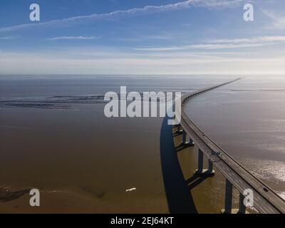 Aerial view of Vasco da Gama bridge crossing the Tagus River, one of the longest suspended bridge in the world, Oriente district, Lisbon, Portugal.