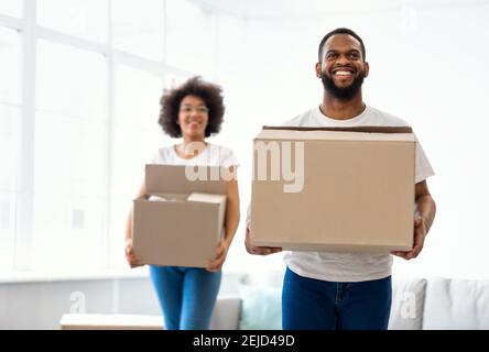 African American Couple Moving Carrying Cardboard Boxes Entering Own House