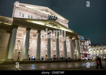 Moscow, Russia - January 17, 2021. Moscow. Red Square Night Russia Winter. People enter through the entrance gate of Bolshoi Theatre, Moscow