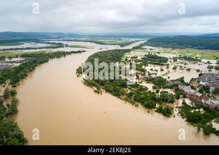 Aerial view of Dnister river with dirty water and  flooded houses in Halych town, western Ukraine. Stock Photo