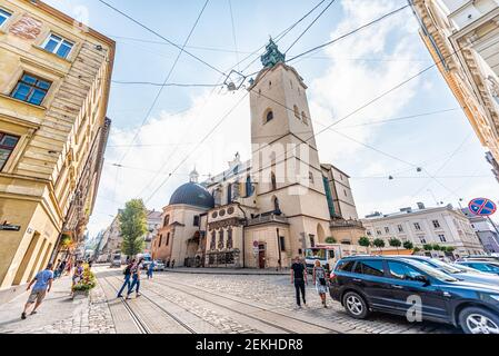 Lviv, Ukraine - August 1, 2018: Latin cathedral Basilica of the Assumption church exterior in historic Ukrainian Lvov city with trolley cables wires o Stock Photo