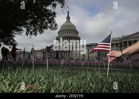 A memorial consisting of 2,977 American flags honoring the victims of 9/11 are displayed at the Capitol on September 11, 2020 in Washington, DC. (Photo by Oliver Contreras/SIPA USA)