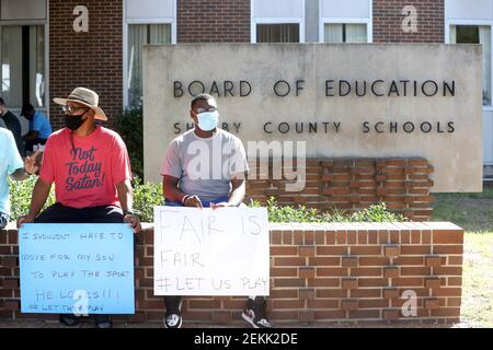 George Thomas Jr. and his son George III join fellow parents and student athletes gathered outside the Shelby County Board of Education offices to protest the decision to postpone fall sports in the district on Wednesday, September 16, 2020 in Memphis, TN. Jrca5267 (Photo by Joe Rondone/The Commercial Appeal/USA Today Network/Sipa USA)