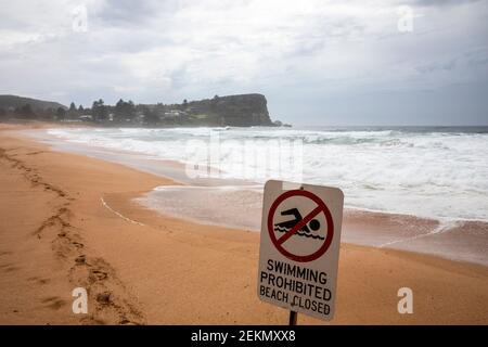 Australian beach closed in Sydney, no swimming sign erected by surf rescue staff, swimming prohibited,Australia Stock Photo