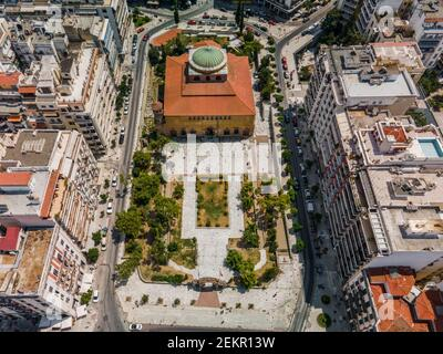 Thessaloniki, Greece aerial drone view of Hagia Sophia Byzantine church, a Christian Orthodox UNESCO World Heritage Site surrounded by buildings.