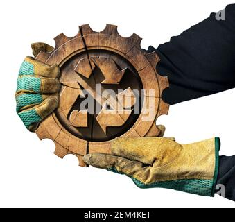 Gloved hands showing a recycling symbol made of wood inside a cogwheel. Sustainable Resources concept. Isolated on white background.