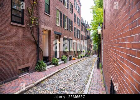 Traditional brick town houses along a narrow stone alley with brick sidewalks in a historic district Stock Photo