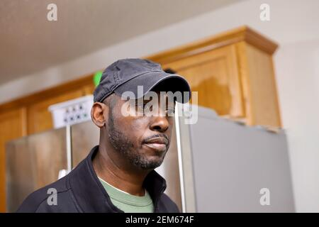 A portrait of a African-American man looking sad and lonely