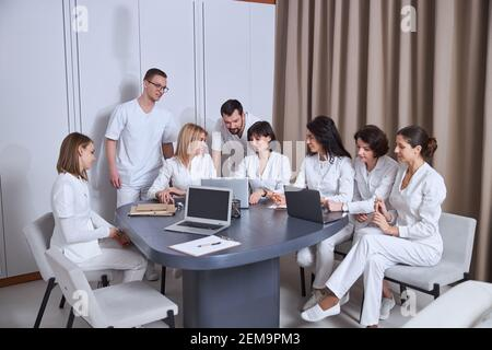 Doctors discussing their patient cases at a brief meeting