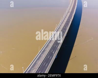 Aerial view of beautiful Vasco da Gama bridge's suspended highway road crossing the Tagus river, one of the world's longest bridge, Oriente district,