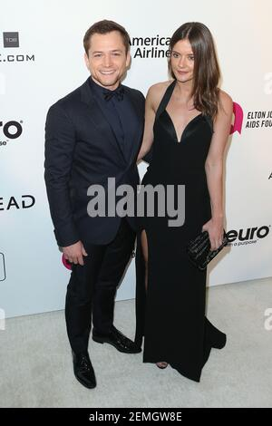 Taron Egerton, Emily Thomas attend the 27th Annual Elton John AIDS Foundation Academy Awards Viewing Party Celebrating EJAF And The 91st Academy Awards held at West Hollywood Park on February 24, 2019 in West Hollywood, California, United States. (Photo by Art Garcia/Sipa USA)