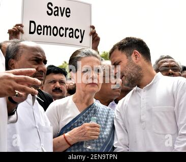 NEW DELHI, INDIA - JULY 11: Congress MP Rahul Gandhi speaks to UPA Chairperson Sonia Gandhi during their 'Save Democracy' protest over Karnataka and Goa issues, in front of the statue Mahatma Gandhi, at Parliament House Complex on July 11, 2019 in New Delhi, India. In Karnataka, legislators of the ruling Congress-JD(S) alliance have resigned plunging the state government into crisis. In Goa, 10 Congress MLAs have joined the ruling BJP.(Photo by Sonu Mehta/Hindustan Times/Sipa USA)