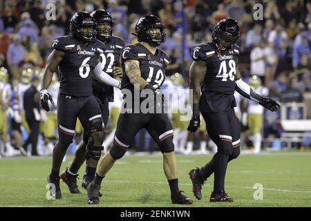 August 29, 2019: Cincinnati's Ethan Tucky (19) struts to celebrate his sack with teammates Perry Young (6) and Kevin Mouhon (48) during an NCAA football game between the Cincinnati Bearcats and the UCLA Bruins at Nippert Stadium in Cincinnati, Ohio. Kevin Schultz/(Photo by Kevin Schultz/CSM/Sipa USA)