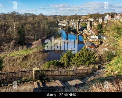 Steps down to Waterside and the viaduct across the River Nidd at Knaresborough North Yorkshire England
