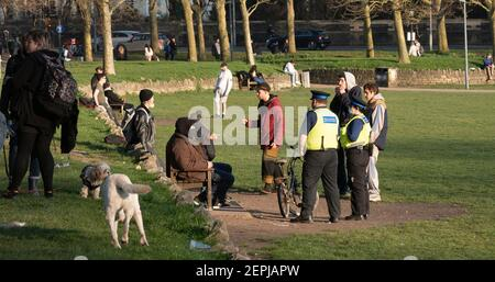 Brighton UK 27th February 2021 - Police Community Support Officers check on people gathering in The Level park in Brighton city centre today as the lockdown restrictions continue in England : Credit Simon Dack / Alamy Live News