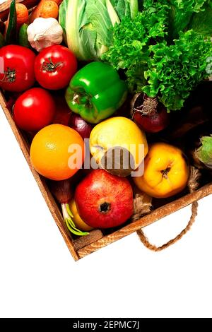 Assortment of fruits and vegetables, in a wooden box, close, vertical, no people, - Stock Photo