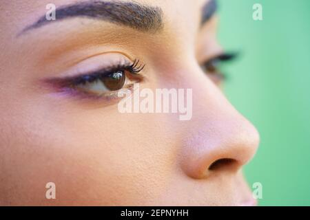 Close-up portrait of beautiful young mixed girl