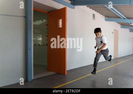 Santiago, Metropolitana, Chile. 1st Mar, 2021. A child runs through the corridors of the school at recess, with the mask on, on the first day of face-to-face classes at the Las Condes municipal school, in the midst of the Coronavirus prevention measures. Credit: Matias Basualdo/ZUMA Wire/Alamy Live News