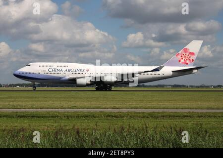 China Airlines Boeing 747-400 with registration B-18206 on take off roll on runway 36L (Polderbaan) of Amsterdam Airport Schiphol.