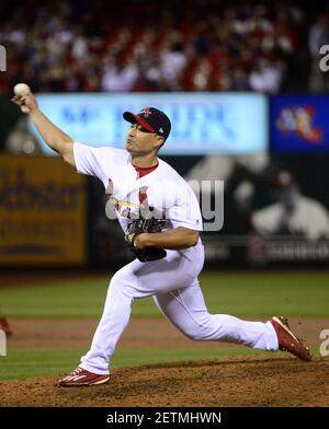 Apr 2, 2017; St. Louis, MO, USA; St. Louis Cardinals relief pitcher Seung-Hwan Oh (26) pitches to a Chicago Cubs batter during the eighth inning of opening night at Busch Stadium. The Cardinals won 4-3. Mandatory Credit: Jeff Curry-USA TODAY Sports *** Please Use Credit from Credit Field ***