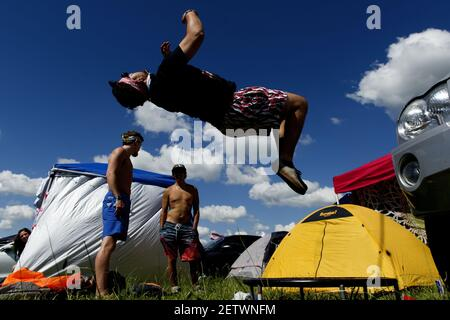 June 8 2017; Manchester, TN, USA; Bridges Tipton, of Memphis, Tennessee, does a backflip off of a small trampoline in the campgrounds at Bonnaroo Music and Arts Festival. Mandatory Credit: Calvin Mattheis/Knoxville News Sentinel via USA TODAY NETWORK *** Please Use Credit from Credit Field ***
