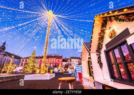Cluj, Transylvania - Night scene with Christmas Market in Romania travel winter scenery in Eastern Europe.