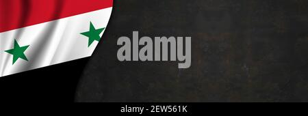 Syria flag on concrete wall. Banner with fabric texture of the flag of Syria. - Stock Photo