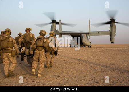 U.S. Marines with the 2nd Battalion, 7th Marine Regiment, Special Purpose Marine Air Ground Task Force - Crisis Response - Central Command, carry a simulated casualty to an MV-22 Osprey during a Tactical Recovery of Aircraft and Personnel exercise at an undisclosed location in Southwest Asia, May 23, 2016. SPMAGTF-CR-CC is ready to respond to any crisis response mission in theater to include the employment of a TRAP force. (Photo by Cpl. Trever Statz/U.S. Marine Corps)   Please note: Fees charged by the agency are for the agency's services only, and do not, nor are they intended to, convey to