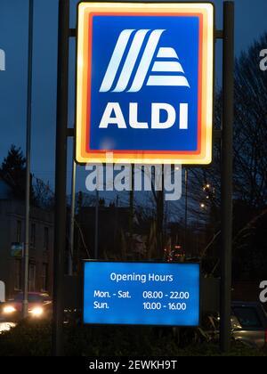 Illuminated Aldi sign in twilight at Westbury, Wiltshire, England, UK.