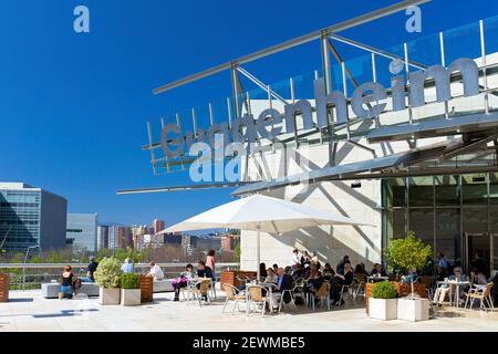 Europe, Spain, Basque Country, Bilbao, Guggenheim Museum Bilbao with Entrance Café. - Stock Photo