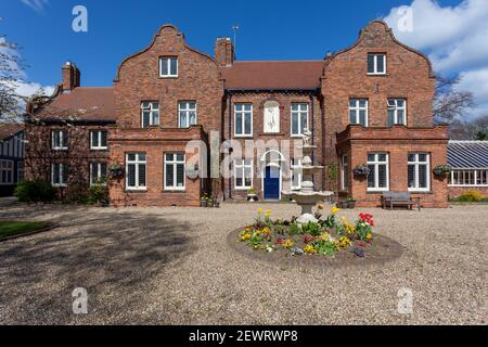 External view of the facade of the historic brick built Old Hall in Hornsea, East Yorkshire