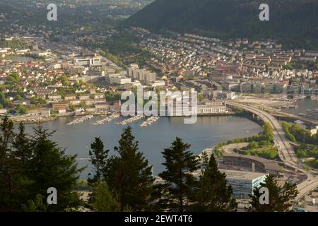 Lovely view of the marina and the surrounding cityscape in the distance from Mount Floyen in Bergen, Norway.
