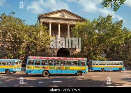 Public transport busses on city road in front of ancient heritage Government building at Dalhousie area of Kolkata