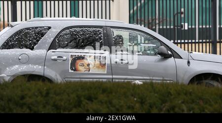 Members of the Brown family, including his mother, Lesley McSpadden, leave the St. Louis FBI offices in a car decorated with Michael Brown's photograph after meeting with federal officials on Wednesday, March 4, 2015. (Photo by David Carson/St. Louis Post-Dispatch/TNS) *** Please Use Credit from Credit Field ***