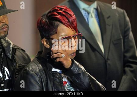 Lesley McSpadden, mother of Michael Brown, wipes a tear away during the press conference on Thursday, March 5, 2015, at the Greater St. Marks Family Church in Dellwood, Mo. Attorneys announced Thursday that Brown's parents plan to file a wrongful-death lawsuit against Darren Wilson and the city of Ferguson. (Photo by J.B. Forbes/St. Louis Post-Dispatch/TNS) *** Please Use Credit from Credit Field ***