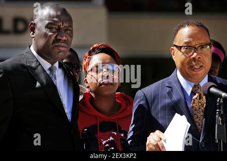 Michael Brown's mother, Lesley McSpadden, center, closes her eyes as attorneys Benjamin Crump, left, and Anthony Gray announce a wrongful-death lawsuit by Brown's relatives on Thursday, April 23, 2015, at the St. Louis County Circuit Court in Clayton, Mo. The suit names as defendants the city of Ferguson, former Police Chief Thomas Jackson and former police officer Darren Wilson. (Photo by Huy Mach/St. Louis Post-Dispatch/TNS) *** Please Use Credit from Credit Field ***