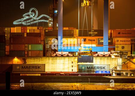 Container Terminal, Gateway West Terminal, Logport 2, cargo ship, in Duisburg on the Rhine, in the background Tiger and Turtle - Magic Mountain is a l Stock Photo