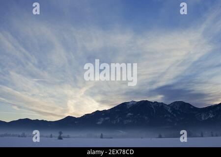 Frosty and foggy sunrise at the alpine rim, Kochelsee, Bavaria Strong hoarfrost in the trees, frosty and foggy sunrise in the ba Stock Photo