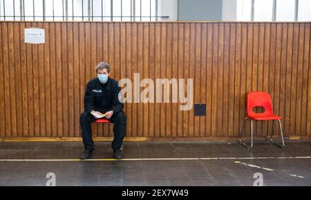04 March 2021, Lower Saxony, Hanover: A police officer waits to be vaccinated against the Corona virus at the Lower Saxony Central Police Directorate. Prioritized vaccination of police officers has begun in Lower Saxony. Photo: Julian Stratenschulte/dpa