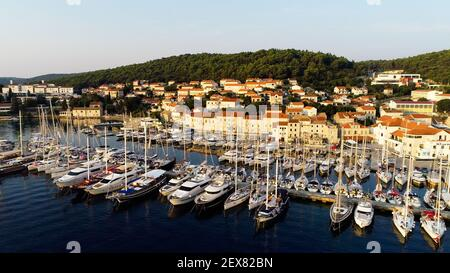 Aerial view of a lot of boats and yachts moored in marina in a summer season. Yacht show festival Croatia, France, Fort Lauderdale, Italy, Monaco. - Stock Photo