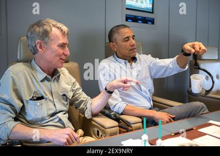 President Barack Obama talks with Bill Nye, the Science Guy, aboard Air Force One en route to Miami, Fla., April 22, 2015. (Photo by Pete Souza/White House) This official White House photograph is being made available only for publication by news organizations and/or for personal use printing by the subject(s) of the photograph. The photograph may not be manipulated in any way and may not be used in commercial or political materials, advertisements, emails, products, promotions that in any way suggests approval or endorsement of the President, the First Family, or the White House. *** Please U