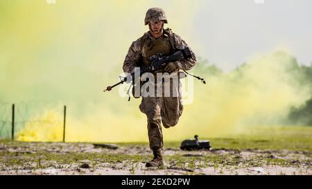 Lance Cpl. Alex Rowan, a combat engineer with 4th Combat Engineer Battalion, 4th Marine Division, stationed out of Bessemer, Ala., runs to take cover before the Anti-Personnel Obstacle Breaching System detonates during the SAPPER Leaders Course aboard Camp Lejeune, N.C., June 26, 2015. During the course, the Marines used assault and breaching techniques to clear a wire obstacle using line charges that utilized C4 explosives and their APOBS. (Photo by Cpl. Krista James/U.S. Marine Corps) *** Please Use Credit from Credit Field ***