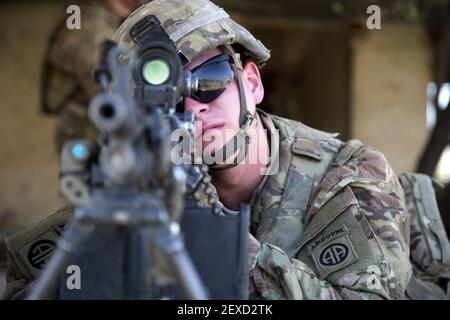 U.S. Army Pfc. Eric Krussier, a paratrooper assigned to Bravo Troop, 5th Squadron, 73rd Cavalry Regiment, 3rd Brigade, 82nd Airborne Division, looks down his sights of his weapon while he pulls security during squad level training at Camp Taji, Iraq, Aug. 3, 2015. Coalition forces routinely practice what they plan to teach Iraqi soldiers prior to each round of instruction. Training at the building partner capacity sites is an integral part of Combined Joint Task Force – Operation Inherent Resolve's multinational effort to train Iraqi security force personnel to defeat the Islamic State of
