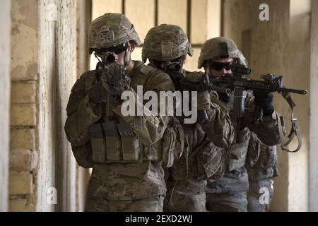 U.S. Army paratroopers assigned to Bravo Troop, 5th Squadron, 73rd Cavalry Regiment, 3rd Brigade, 82nd Airborne Division, maneuver through a hallway as part of squad level training at Camp Taji, Iraq, Aug. 3, 2015. Coalition forces routinely practice what they plan to teach Iraqi soldiers prior to each round of instruction. Training at the building partner capacity sites is an integral part of Combined Joint Task Force – Operation Inherent Resolve's multinational effort to train Iraqi security force personnel to defeat the Islamic State of Iraq and the Levant. A coalition of regional and i