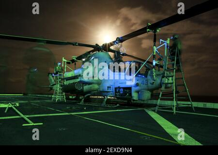U.S. Marines with Marine Medium Tiltrotor Squadron 161 (Reinforced), 15th Marine Expeditionary Unit, perform post-flight maintenance on an AH-1Z Viper aboard the USS Anchorage (LPD 23) in the Philippine Sea, June 2, 2015. The Marines of VMM-161 (Rein.) work day and night to ensure the aircraft are mission capable. (Photo by Sgt. Jamean Berry/U.S. Marine Corps) *** Please Use Credit from Credit Field ***