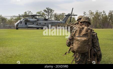 Marines with Marine Rotational Force – Darwin, and Australian soldiers board a CH-53E Super Stallion helicopter with Marine Heavy Helicopter Squadron 463, MRF-D, Aug. 7, 2015. The rotational deployment in Darwin enables Marines to more effectively train, exercise and operate with their partners, enhancing regional security and building a capacity to respond more rapidly to natural disasters and crises throughout that region. (Photo by Cpl. Reba James/U.S. Marine Corps) *** Please Use Credit from Credit Field ***