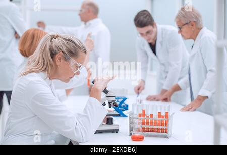 female scientist sitting at a Desk in the laboratory.