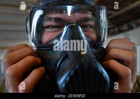 Airman 1st Class Kyle Denzine, a 20th Operations Support Squadron aircrew flight equipment specialist, checks the seal of his gas mask at Shaw Air Force Base, S.C., Oct. 23, 2015. Denzine, along with other AFE Airmen, practiced the actions they would take in the event a pilot needs to be decontaminated upon his return to base. (Photo by Senior Airman Michael Cossaboom/U.S. Air Force) *** Please Use Credit from Credit Field ***