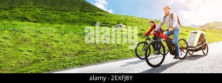 Family Riding Electric Mountain Bike Or Bicycle In Mountains